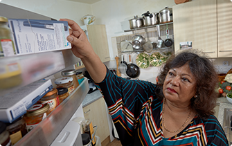 Woman removing insulin pen from the fridge