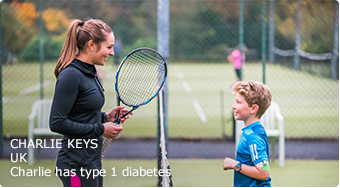Young type 1 patient (Charlie) standing on tennis court opposite woman with tennis racket