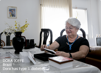 Type 1 patient (Dora) sitting at table looking at photos
