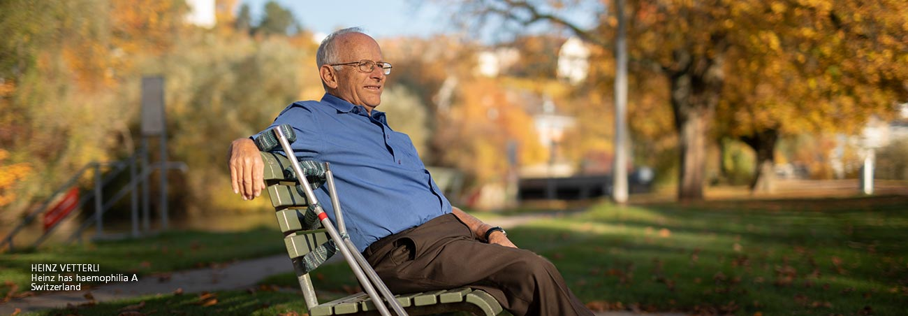 Heinz, an elderly man - sits on bench, looking happy